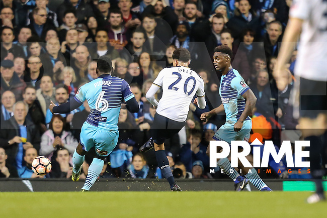 Dele Alli of Tottenham Hotspur (20) scores his team's third goal of the game to make the score 3-3 during the FA Cup 4th round match between Tottenham Hotspur and Wycombe Wanderers at White Hart Lane, London, England on 28 January 2017. Photo by PRiME Media Images / David Horn.