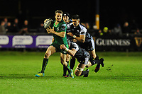 Jack Carty of Connacht is tackled by Dan Lydiate of Ospreys during the Guinness Pro14 match between the Ospreys and Connacht Rugby at Morganstone Brewery Field in Bridgend, Wales, UK. Friday 26 October 2018