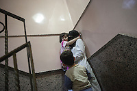 Rashed reacts in panic embracing her mother Fatimah, as they take cover downstairs of the Dar Al-Shifa hospital, while a round of mortar shells hit the structure of the building during an attack. October 17, 2012.