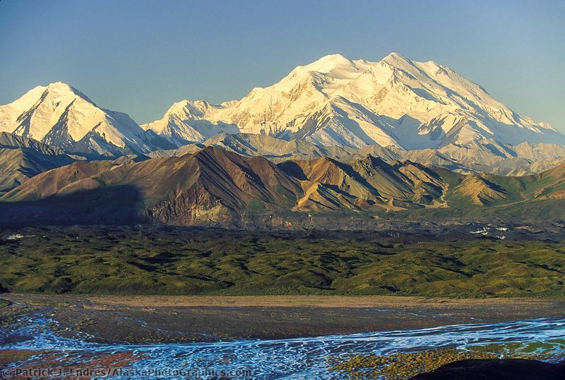 Denali, North and South peaks of North America's highest mountain, summer, Muldrow glacier moraine and Thorofare river in foreground, Denali National Park, Alaska