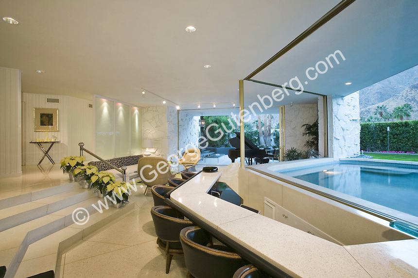 Contemporary living room with view of pool