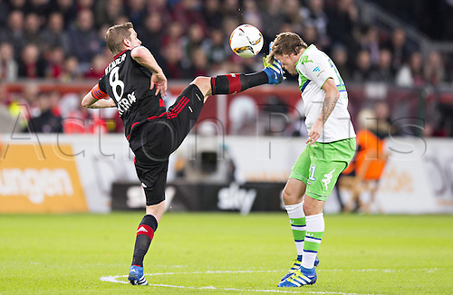 01.04.2016. Leverkusen, Germay. Bundesliga football. Bayer Leverkusen versus VFL Wolfsburg in the BayArena in Leverkusen.  Max Kruse (Wolfsburg)  gets a high boot from Lars Bender Bayer
