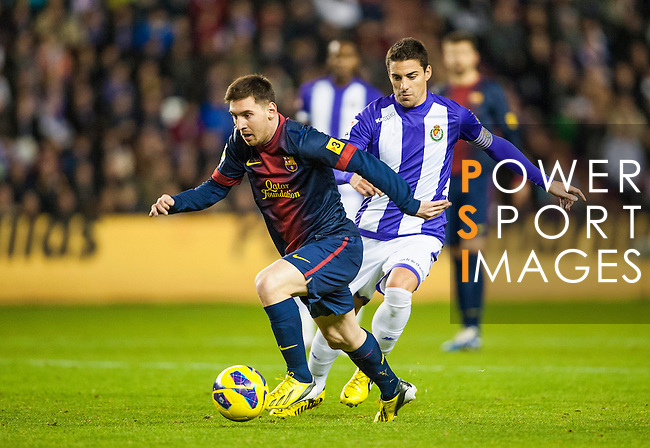 VALLADOLID, SPAIN - DECEMBER 22:  Lionel Messi (R) of Barcelona fights for the ball during the La Liga game between Real Valladolid and FC Barcelona at Jose Zorrilla on December 22, 2012 in Valladolid, Spain. Photo by Victor Fraile / The Power of Sport Images