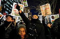 A woman demonstrate outside of City Hall against police violence as another group attend a rally in support of the New York Police Department (NYPD)  in New York December 19,2014 . Kena Betancur/VIEWpress