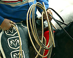 The hard working hands of a Harry Vold Rodeo Company rodeo cowboy pick up man, holding the tools of the trade during competition at the 2007 Cheyenne Frontier Days Rodeo in Cheyenne, Wyoming. Rodeo pick up men are invaluable in the production of a rodeo. The pick up men aid in safely moving livestock through the arena, and provide assistance to roughstock cowboys at the completion of each ride.