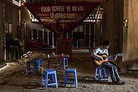 PA KHAU, Vietnam: A young member of the Pa Khau church is playing guitar inside the church of the village, 23th February 2017.