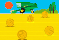 Combine harvester in field of euro coin hay bales