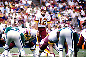 Washington Redskins punter / place kicker Steve Cox (12) prepares to kick a 55 yard field goal during the game against the Philadelphia Eagles at RFK Stadium in Washington, DC  on September 7, 1986.  The Redskins won the game 41 - 14.<br /> Credit: Arnie Sachs / CNP