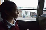Yarely Arellano rides a bus in the Mexican city of Juarez as she travels home after crossing the border from the United States, where she studies at the Lydia Paterson Institute, a United Methodist sponsored high school in El Paso, Texas. Arrelano, 20, makes the journey every school day.