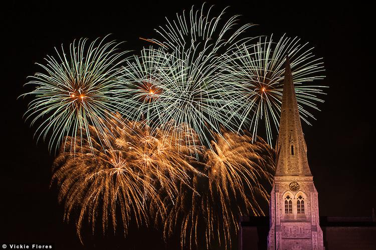 Fireworks explode behind All Saints church in Blackheath on 3 November 2012