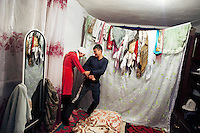 Newly weds Dinara and her husband Ahmad play in their room during the first week after their marriage.  Dinara was kidnapped by Ahmat who wanted to marry her. After resisting for 5 hours, she finally accepted. 'I didn't know Ahmad well and didn't want to stay there. But I accepted because this is our tradition' Dinara says. Although illegal, bride kidnapping is common in rural parts of Kyrgyzstan. Each year around 16, 000 women become married after being kidnapped. They are known as 'Ala Kachuu' that translates as 'to grab and run away'. Defenders of the continuation of the practice sight tradition. However, during Soviet Times it was rare, and parents generally arranged marriages..