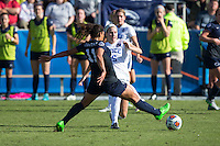 Cary, North Carolina - Sunday December 6, 2015: Kara Wilson (15) of the Duke Blue Devils kicks the ball away from  Raquel Rodriguez (11) of the Penn State Nittany Lions during second half action at the 2015 NCAA Women's College Cup at WakeMed Soccer Park.  The Nittany Lions defeated the Blue Devils 1-0.