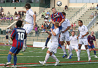 Andrew Marshall #5 of Crystal Palace Baltimore heads over Eduardo Sebrano #12 of the Montreal Impact during an NASL match at Paul Angelo Russo Stadium in Towson, Maryland on August 21 2010. Montreal won 5-0.