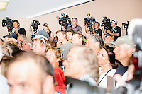 Television crews line a wall as real estate mogul and Republican presidential candidate Donald Trump speaks to supporters at a rally at the Weirs Beach Community Center in Laconia, New Hampshire.