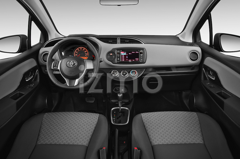 Stock photo of straight dashboard view of a 2015 Toyota Yaris LE 3-Door Liftback AT 3 Door Hatchback Dashboard