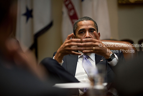 Washington, DC - December 8, 2009 -- United States President Barack Obama gestures during the Economic Daily Briefing in the Roosevelt Room of the White House, Tuesday, December 8, 2009.  .Mandatory Credit: Pete Souza - White House via CNP