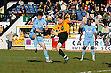 David McGurk of York heads towards goal under pressure from Mark Bentley of Cambridge United (on loan from Gillingham)  during the Blue Square Bet Premier match between Cambridge United and York City at the Abbey Stadium, Cambridge on 19th March, 2011.© Kevin Coleman 2011