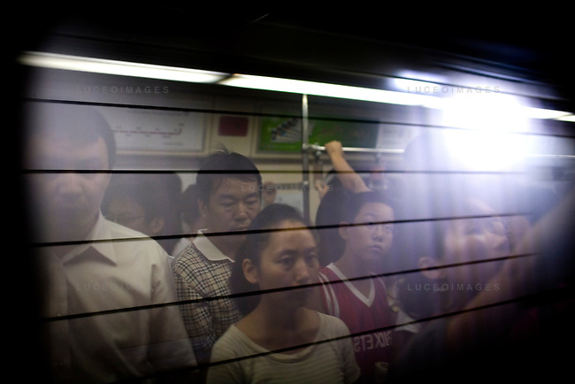 Beijingers take ride the subway in Beijing, China on Tuesday, August 12, 2008.  Kevin German