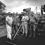 Scan of vintage black and white print. Negative file# 98-103. HRI, Inc. highway crew with paver. 1/1