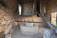 Reconstructed Roman oil press in a house in Volubilis, Northern Morocco, where olive growing was the main industry. Volubilis was founded in the 3rd century BC by the Phoenicians and was a Roman settlement from the 1st century AD. Volubilis was a thriving Roman olive growing town until 280 AD and was settled until the 11th century. The buildings were largely destroyed by an earthquake in the 18th century and have since been excavated and partly restored. Volubilis was listed as a UNESCO World Heritage Site in 1997. Picture by Manuel Cohen