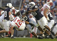 13 October 2007:  Penn State's Chris Baker (93) and Maurice Evans (48) send Wisconsin QB Tyler Donovan (12) air born after  a pass.  The Penn State Nittany Lions defeated the Wisconsin Badgers 38-7 October 13, 2007 at Beaver Stadium in State College, PA..
