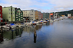 Warehouses and boats in harbour, River Nidelva, Trondheim, Norway