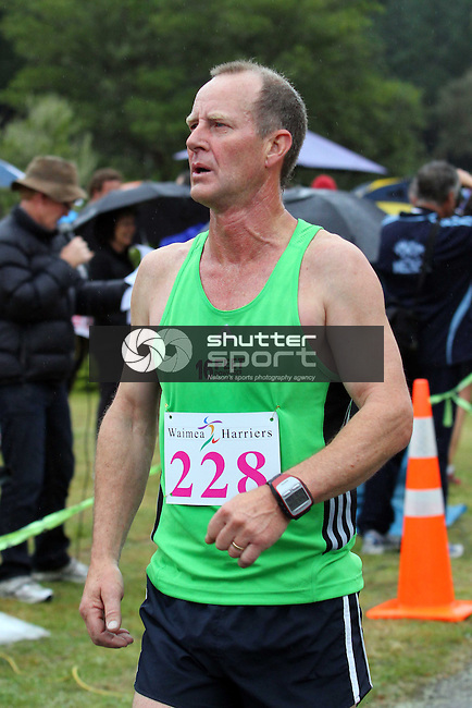 John Shaw finishing. Half Marathon &amp; Road Relay, Rabbit Island, SI Masters Games, 22 October 2011, Nelson, New Zealand<br /> Photo: Marc Palmano/shuttersport.co.nz