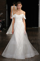 """Model walks runway in an """"Affinity"""" bridal gown from the Rivini by Rita Vinieris Fall 2017 collection on October 7th, 2016 during New York Bridal Fashion Week."""