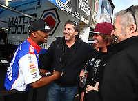 Feb 7, 2014; Pomona, CA, USA; NHRA top fuel dragster driver Antron Brown socializes with some fans during qualifying for the Winternationals at Auto Club Raceway at Pomona. Mandatory Credit: Mark J. Rebilas-