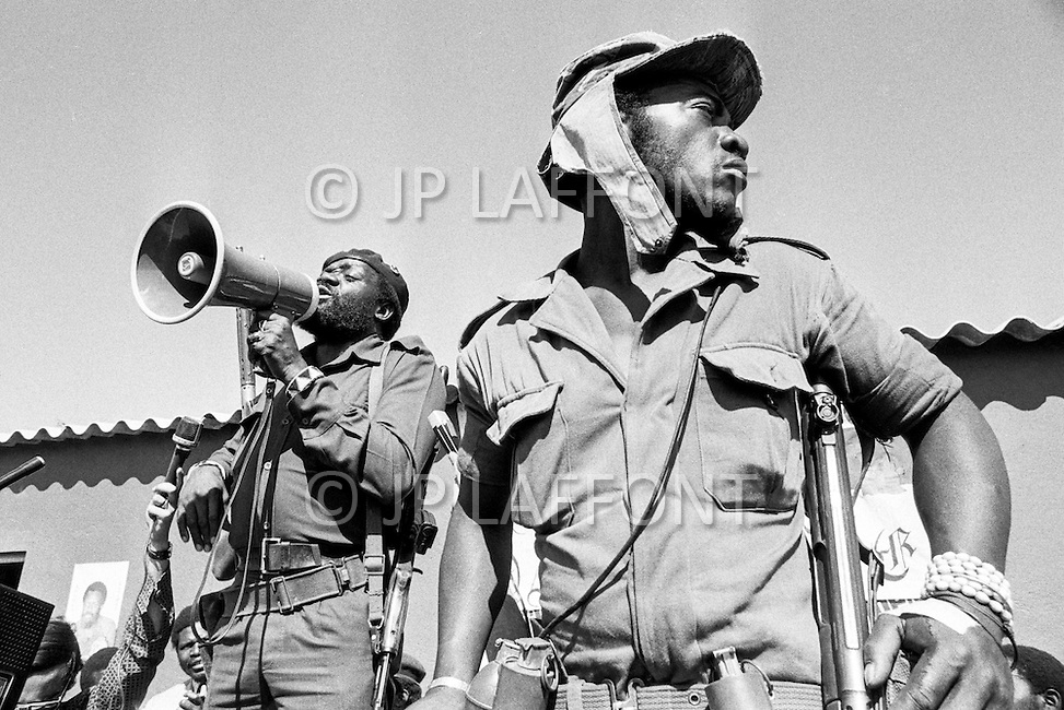 July 1975, Angola --- Jonas Savimbi (L), leader of the National Union for the Total Independence of Angola (UNITA) in South Angola. | Location: Sa da Bandeira, Angola. --- Image by © JP Laffont