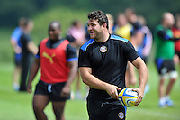 Nathan Catt looks to pass the ball. Bath Rugby pre-season training session on July 18, 2014 at Farleigh House in Bath, England. Photo by: Patrick Khachfe/Onside Images