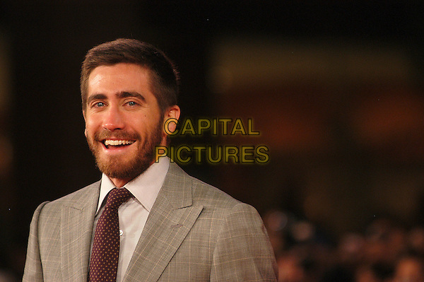 "JAKE GYLLENHAAL.Attends the Film Premiere of ""Rendition"" during the .2nd Annual Rome Film Festival, Rome, Italy, .October 21st 2007..half length grey suit jacket red tie beard.CAP/CAV.©Luca Cavallari/Capital Pictures."