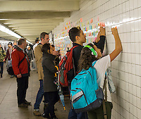 """Thousands of travelers write their thoughts about the results of the presidential election on post-it notes as part of the """"Subway Therapy"""" project by Matthew Chavez in the subway in New York, seen on Tuesday, November 15, 2016. Chavez started the project yo enable New Yorkers to vent their emotions on the election of Donald Trump. Many wrote angry messages and some wrote messages of hope and some now felt they were not alone and part of a community. (© Richard B. Levine)"""