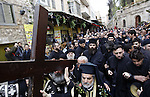 Orthodox Christians carry crosses on the Via Dolorosa as they approach the Church of the Holy Sepulchre during the Good Friday processions retracing the route taken by Jesus Christ to his crucifixion, in Jerusalem's Old City on 10 April 2015. Photo by Saeb Awad