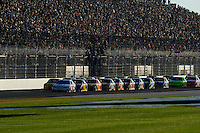 The field races on the back straight led by Clint Bowyer (#33) and Kasey Kahne (#9).