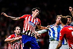 Stefan Savic of Atletico de Madrid (L) fights for position with David Zurutuza Veillet of Real Sociedad (R) during the La Liga 2018-19 match between Atletico de Madrid and Real Sociedad at Wanda Metropolitano on October 27 2018 in Madrid, Spain.  Photo by Diego Souto / Power Sport Images