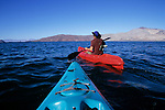 Kayakers traverse Bahia de los Angeles on the Sea of Cortez (Gulf of California), Baja California, Mexico