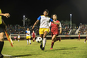 a Xerente player hold off her opponent from the USA during the final of the women's football, between the local Xerente tribe and the Native American team from Canada at the International Indigenous Games in the city of Palmas, Tocantins State, Brazil. The USA won on a penalty shoot-out after a 0-0 match. Photo © Sue Cunningham, pictures@scphotographic.com 30th October 2015