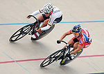 June 23, 2012: Germany's, Kristina Vogel (left), comes over the top against USA's, Dana Feiss (right), during quarterfinal action in the Women's Sprint competition at the U.S. Grand Prix of Sprinting, Seven Eleven Velodrome, Colorado Springs, CO.