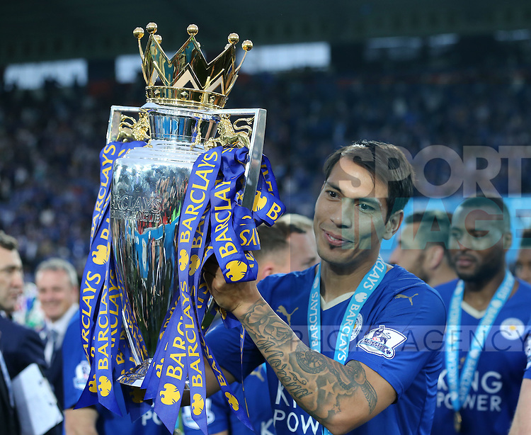 Leicester's Leonardo Ulloa celebrates with the trophy during the Barclays Premier League match at the King Power Stadium.  Photo credit should read: David Klein/Sportimage