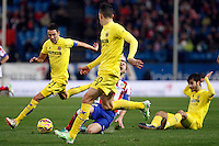 Gabi of Atletico de Madrid and Bruno and Gabriel of Villarreal during La Liga match between Atletico de Madrid and Villarreal at Vicente Calderon stadium in Madrid, Spain. December 14, 2014. (ALTERPHOTOS/Caro Marin) /NortePhoto