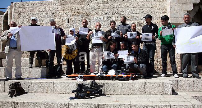 Sit-in organized by Palestinian  journalists in the Damascus Gate in East Jerusalem to stop the ongoing attacks against jounalists in many areas in Palestine and other countries on16 March 2011.Photo by Sliman Khader.