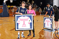 25 February 2012:  FIU's Tanner Wozniak (23) presents a jersey to Linda Burrows during a ceremony honoring cancer survivors prior to the game.  The FIU Golden Panthers defeated the University of South Alabama Jaguars, 81-74, at the U.S. Century Bank Arena in Miami, Florida.
