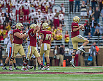 2 November 2013: Boston College Eagles quarterback Chase Rettig (11) celebrates with teammates after the clock runs out against the Virginia Tech Hokies at Alumni Stadium in Chestnut Hill, MA. The Eagles defeated the Hokies 34-27. Mandatory Credit: Ed Wolfstein-USA TODAY Sports *** RAW (NEF) Image File Available ***