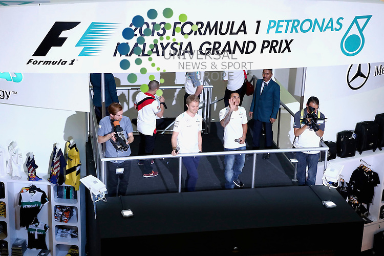 Formula 1 Petronas Malaysia Grand Prix, 22. - 24.03.2013 .Nico Rosberg(D), Mercedes GP, Lewis Hamilton (GB), Mercedes GP..The 2013 Formula 1 Petronas Malaysia Grand Prix in Sepang this weekend to paint a clearer but by no means definitive picture as they all get to run Pirelli's new tyres in much warmer temperatures. Picture: Hasan Bratic /Universal News And Sport (Europe) March 21 March 2013.