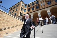 NWA Democrat-Gazette/DAVID GOTTSCHALK  Martin Shoppmeyer, superintendent of Haas Hall Academy, walks Tuesday, July 25, 2017, down the south steps of the new Haas Hall Academy Rogers Campus in Rogers. The campus is in the former historic Lane Hotel in the Rogers Commercial Historic District.