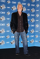 """20 March 2020 - Kenny Rogers, whose legendary music career spanned nearly six decades, has died at the age of 81. Rogers was inducted to the Country Music Hall of Fame in 2013."""" He had 24 No. 1 hits and through his career more than 50 million albums sold in the US alone. He was a six-time Country Music Awards winner and three-time Grammy Award winner. Some of his hits included """"Lady,"""" """"Lucille,"""" """"We've Got Tonight,"""" """"Islands In The Stream,"""" and """"Through the Years."""" His 1978 song """"The Gambler"""" inspired multiple TV movies, with Rogers as the main character. File Photo:10 April 2006 - Nashville, Tennessee - Kenny Rogers. 2006 CMT Music Awards held at The Curb Event Center at Belmont University. Photo Credit: George Shepherd/AdMedia"""