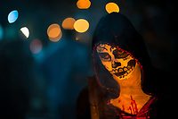 A Salvadoran girl with skull face paint takes part in the La Calabiuza parade at the Day of the Dead festivity in Tonacatepeque, El Salvador, 1 November 2016. The festival, known as La Calabiuza since the 90s of the last century, joins Salvador's pre-Hispanic heritage and the mythological figures (La Sihuanaba, El Cipitío, La Llorona etc.) collected from the whole Central American region, together with the catholic All Saints Day holiday and its tradition of honoring the dead relatives. Children and youths only, dressed up in scary costumes and carrying painted carts, march from the local cemetery to the downtown plaza where the party culminates with music, dance, drinking and eating pumpkin (Ayote) with honey.