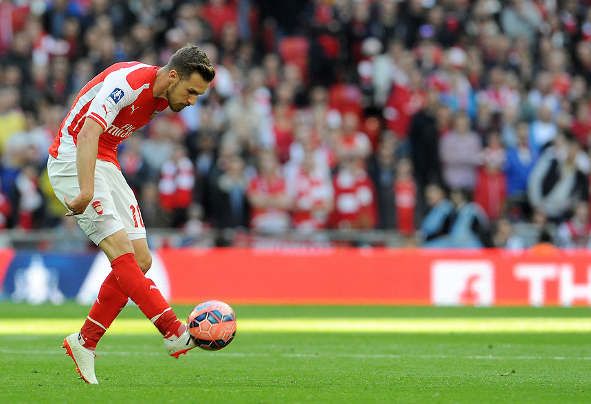 Arsenal's Aaron Ramsey in action during todays match  <br /> <br /> Photographer Ian Cook/CameraSport<br /> <br /> Football - The FA Cup Semi-Final - Reading v Arsenal - Saturday 18th April 2015 - Wembley - London<br /> <br /> &copy; CameraSport - 43 Linden Ave. Countesthorpe. Leicester. England. LE8 5PG - Tel: +44 (0) 116 277 4147 - admin@camerasport.com - www.camerasport.com