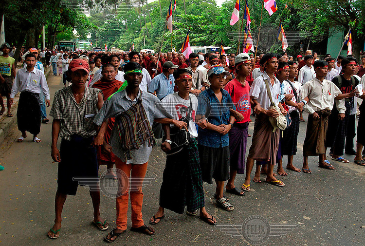The army has blocked the progress of this demonstration and have warned them that they will start firing if the protesters do not move on. Protests led by Buddhist monks calling for the overthrow of the country's military junta continued despite a new threat that the military would shoot on sight any gatherings of over four people.